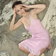图库照片: Lady in pink sundress on sand quarry