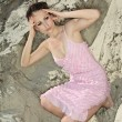 Foto Stock: Lady in pink sundress on sand quarry