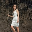Lady in white sundress in ground quarry - Stock Photo