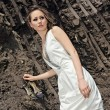 Lady in white sundress inside a deep bla - Stock Photo