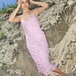 Lady in pink  sundress on sand quarry — Stock Photo