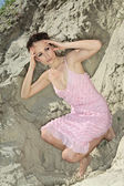 Lady in pink sundress on sand quarry — Стоковое фото