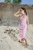 Lady in pink sundress on sand quarry — Stok fotoğraf