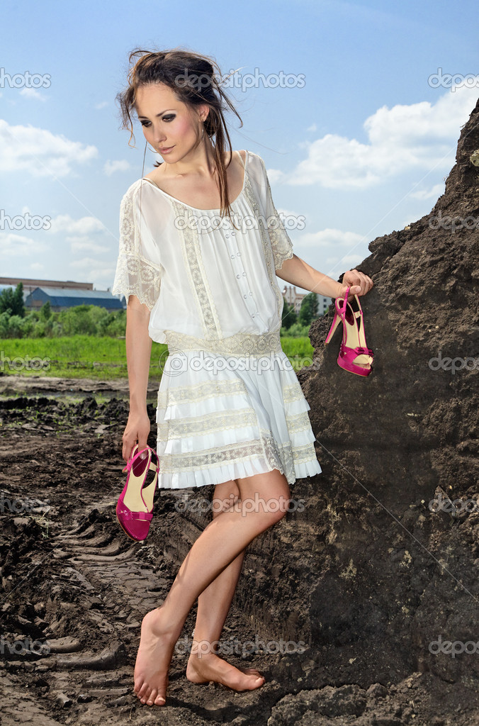 Barefooted lady in white outdoors — Stock Photo ...