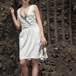 Lady in white sundress inside a quarry - Stock Photo