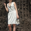 Lady in white sundress inside quarry — Foto de stock #1650392
