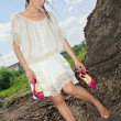 Barefooted attractive lady in white - Stock Photo