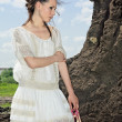 Barefooted beauty lady in white outdoor — Stock Photo