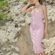 Lady in a pink sundress on sand quarry - Stok fotoğraf