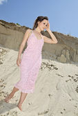 Lady in a pink sundress on sand quarry — Stok fotoğraf