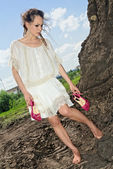Barefooted attractive lady in white — Stock Photo