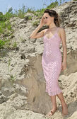 Lady in a pink sundress on sand quarry — Stockfoto