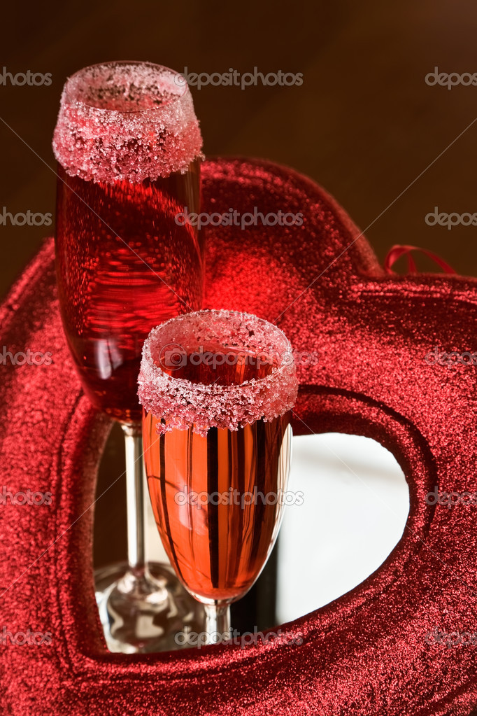 Two champagne glasses Valentine day cocktail decorated with red heart — Stock Photo #1704712