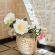 Stock Photo: Peony flowers in pottery vase