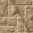 Ashlar wall with brickwork pattern - Stock Photo