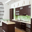 Modern Kitchen with hardwood furniture - Stock Photo