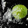Lime (lemon)  falling in water on black — Stock Photo