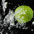 Lime (lemon) falling in water on black — Stock Photo #2176480
