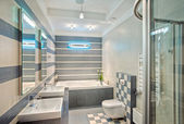Modern bathroom in blue and gray — Foto de Stock