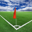 Red flag in a football ground corner — Stock Photo