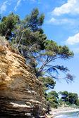 Rocky seacoast on azure coast — Stock Photo