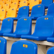 Stock Photo: Dark blue seats on sports tribune