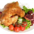 Fried chicken leg on a plate - Stock Photo