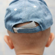 Back of child head and cap — Stock Photo #1061140