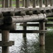 Wood bridge on water — Stock Photo