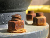 Old rusty metal nut on iron water valve — Stock Photo