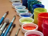 Brushes and paints on table — Stock Photo