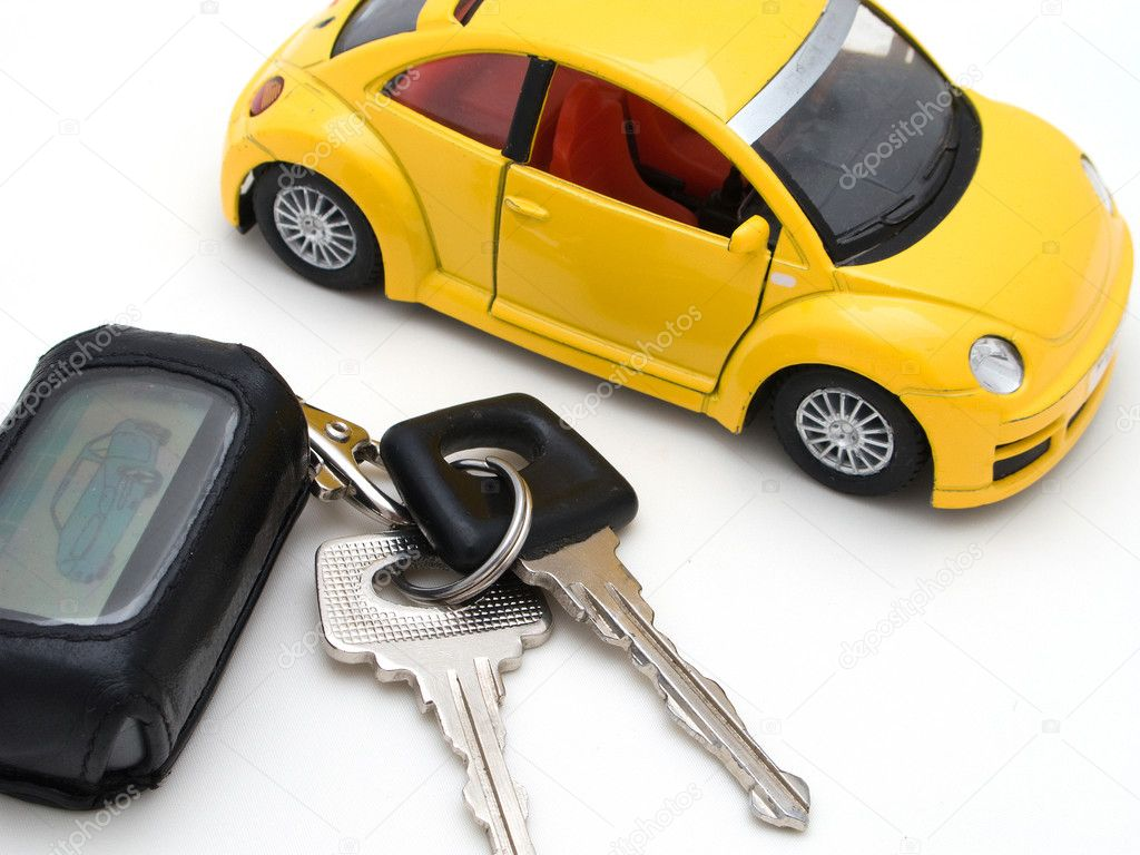Car key ring and driving vehicle isolated on white — Stock Photo #1061721