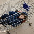 Child in shopping cart — Stock Photo #1854948