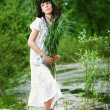 Stock Photo: Beautiful girl with herbs