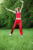 Young sports woman outdoor photo with te — Stock Photo