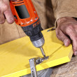 Carpenter with red drill — Stock Photo