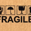 Fragile symbol on cardboard — Stock Photo