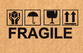 Símbolo frágil en cartón — Foto de Stock