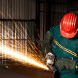 Stock Photo: Heavy industry manual worker with grinde