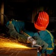 Heavy industry manual worker with grinde - Stockfoto