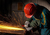 Heavy industry manual worker with grinde — ストック写真