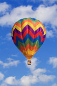 Clouds and hot air balloon — Stock Photo