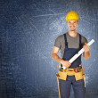 Handyman blue background — Stock Photo