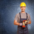 Stock Photo: Young confident handyman