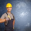 Handyman and grunge background — Stock Photo
