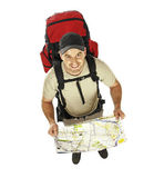 Man with backpack and map — Stock Photo
