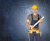 Handyman blue background — Stock Photo