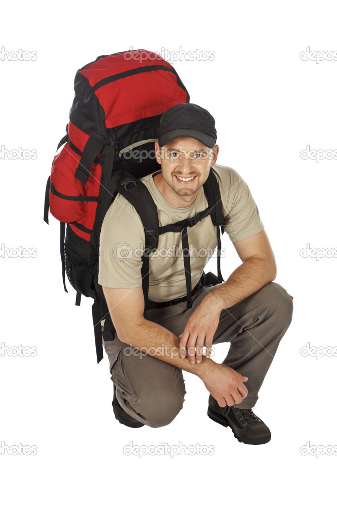 Crounced travel man with big backpack on his back isolated on white — Stock Photo #1196811