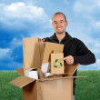 Grass and sky man recycling paper — Stock Photo