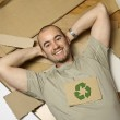 Caucasian man and recycling paper — Stock Photo